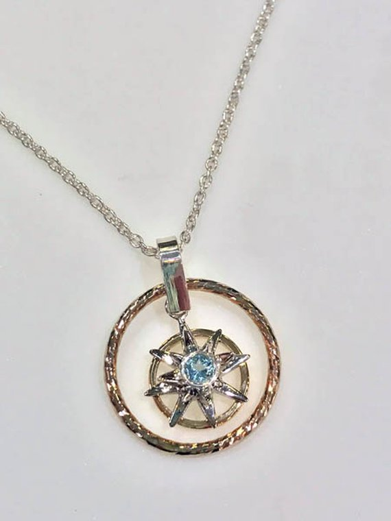 Custom pendant with blue topaz designed by Zack